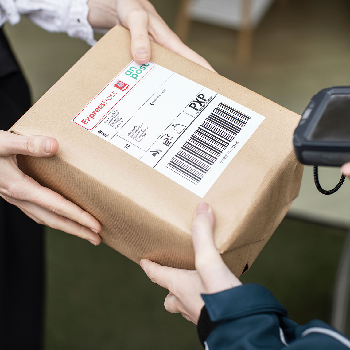 Package being scanned by postperson